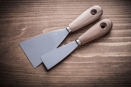 patching: two putty knifes with wooden handles.