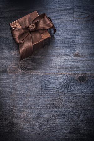 glittery: Present box glittery paper bow on wood board holiday concept. Stock Photo