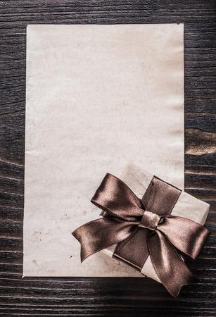 giftbox: Giftbox paper on vintage wooden board vertical version.