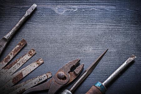 manual measuring instrument: screwdriver vintage metallic meter pliers rasp.
