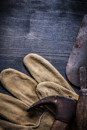 claw hammer: vertical vintage tools claw hammer and putty spattle.
