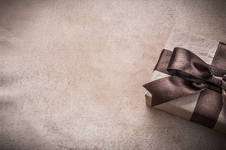 giftbox: Giftbox paper on vintage background holiday concept.