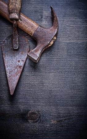 claw hammer: vintage tools putty knife claw hammer on wood board.