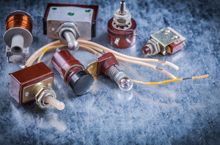 electrical equipment: Group of vintage electrical equipment on metallic background electricity concept.