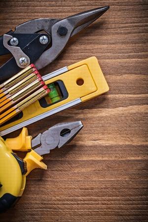 snips: Pliers tape-measure steel cutter construction level wooden meter vertical version.