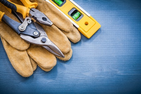 construction level: Pliers steel cutter construction level leather protective gloves.