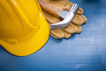 hard hat: Close up view of hard hat claw hammer protective gloves.