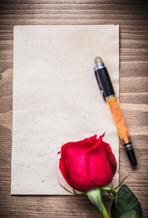 expanded: Blank sheet of paper expanded rose fountain pen holiday concept.