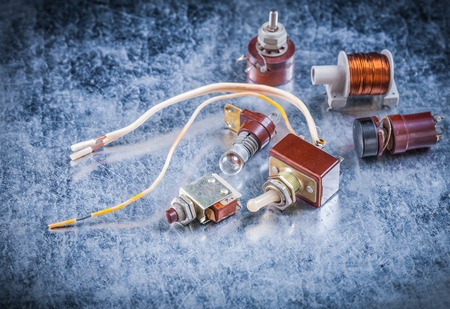 electrical equipment: Collection of electrical equipment on metallic background vintage electricity concept.