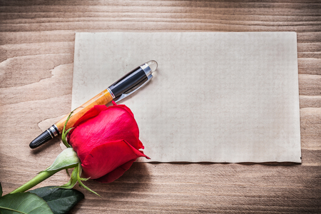 expanded: Blank sheet of paper red rose fountain pen holiday concept.