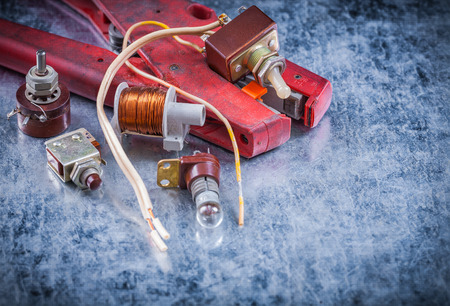 strippers: Wire strippers toggle lamp-holder transformer vintage electricity concept. Stock Photo