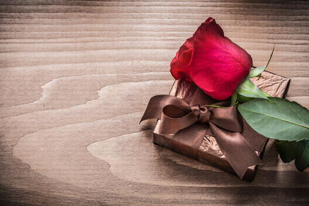 giftbox: Giftbox red rose on wooden board holiday concept.