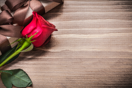 expanded: Expanded red rosebud giftboxes on wooden board holiday concept. Stock Photo