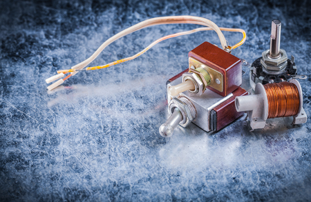 toggle switch: Vintage electric toggle switch transformer on metallic background electricity concept. Stock Photo