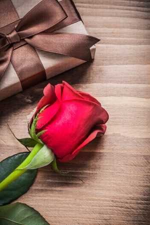 wood rose: Packed present with bow red rose holiday concept.