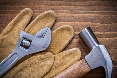 adjustable spanner: Adjustable spanner claw hammer safety gloves construction concept. Stock Photo