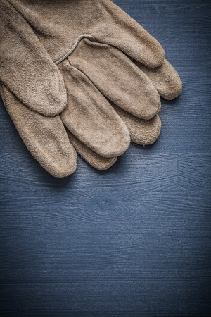 safety gloves: two safety gloves on blue board.