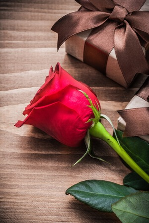 expanded: Expanded natural rose gift boxes on wood board holiday concept.