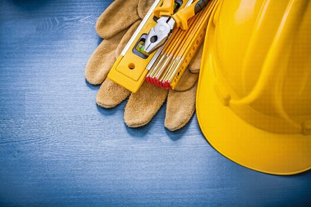 hard hat: Collection of pliers hard hat wooden meter protective gloves.