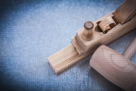 planer: Planer lump hammer wooden stud on metallic background construction concept.