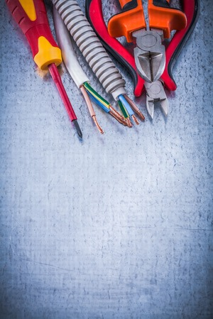 electrical equipment: Nippers insulated screwdriver corrugated pipe wire protection copy space.