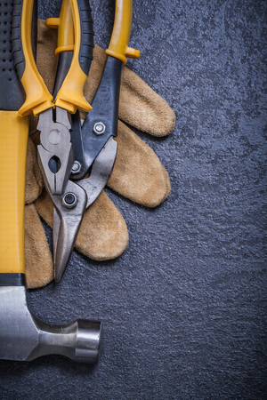 claw hammer: Set of steel cutter pliers leather safety glove claw hammer.