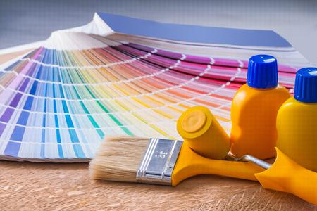 paintroller: bottles of paint paintbrush paintroller color palette.