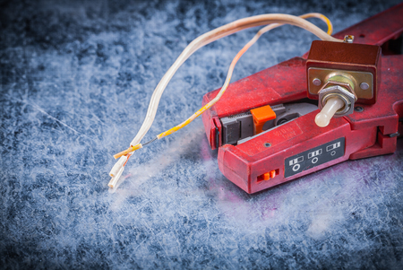 strippers: Wire strippers toggle on scratched metallic background electricity concept. Stock Photo