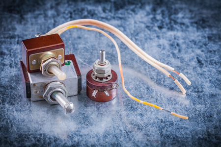 dielectric: Set of vintage electric toggles on metallic background electricity concept.