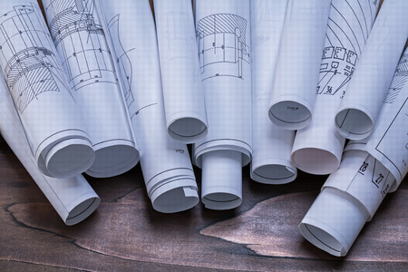 piny: Rolls of construction plans on pine wooden vintage board maintenance concept Stock Photo