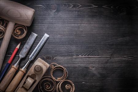 scobs: Firmer chisels shaving plane wooden chips lump hammer pencil.