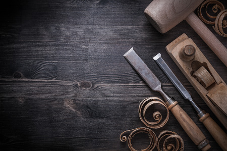 chisels: Chisels shaving plane lump hammer planning chips on wooden board. Stock Photo
