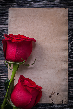 expanded: Blank vintage paper red expanded roses on wooden board.
