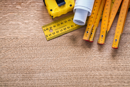 oaken: Construction plans and instruments of measurement on oaken wooden board maintenance concept Stock Photo