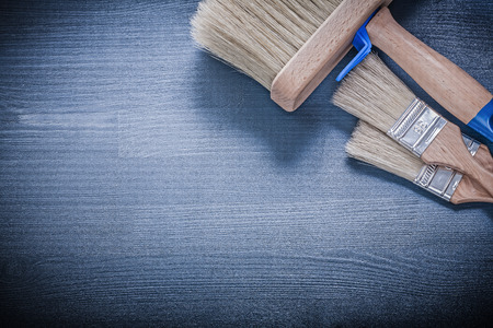 repaint: Composition of paintbrushes on wood board construction concept. Stock Photo