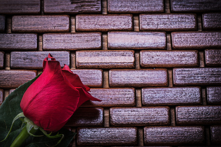 matting: Aromatic red rose on wicker wooden matting holiday concept. Stock Photo