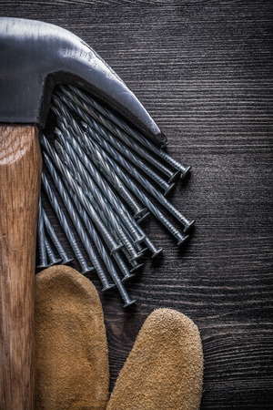 claw hammer: Composition of leather protective gloves construction nails claw hammer.