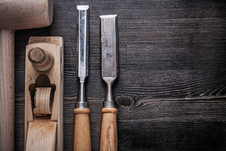 wood planer: Composition of wooden hammer metal chisels planer on wood board. Stock Photo