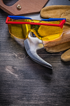 protective goggles: Hand saw claw hammer protective goggles leather gloves.