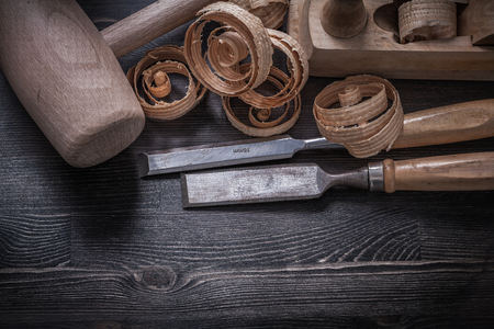 scobs: Chisels shaving plane wooden scobs lump hammer construction concept.