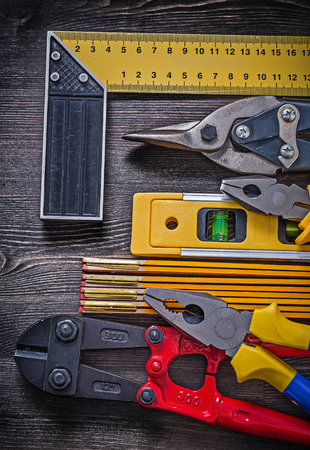 snips: Composition of construction tooling on wooden board maintenance concept.