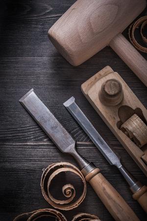 planer: Flat chisels planer lump hammer planning chips on wooden board.