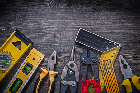snips: Group of construction tooling on wooden background maintenance concept.