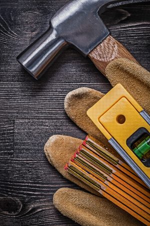 claw hammer: Collection of claw hammer protective gloves wooden meter construction level. Stock Photo