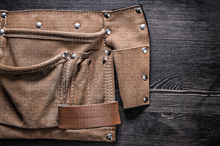 leather bag: Leather bag for tooling on wooden board construction concept.