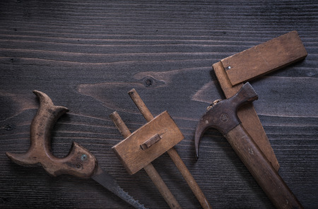claw hammer: Rusted hand saw wooden marking gauge claw hammer square ruler.