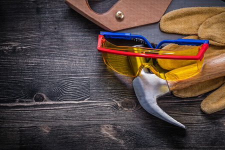 industrial safety: Hand saw claw hammer safety glasses leather gloves.