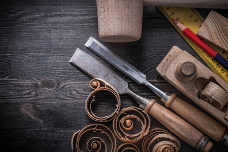 scobs: Composition of joiner tools on wooden board construction concept. Stock Photo