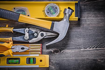 snips: Construction level wooden meter pliers tin snips hammer horizontal version. Stock Photo