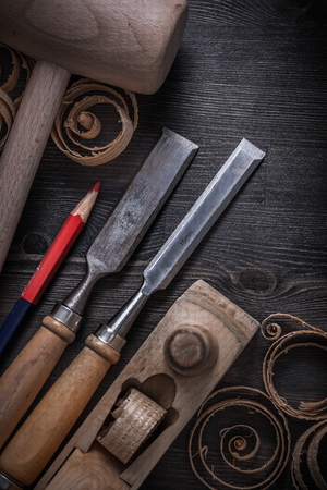 chisels: Firmer chisels shaving plane wooden chips mallet pencil. Stock Photo